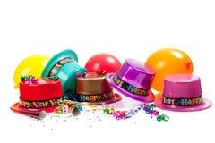 Hüte des glücklichen neuen Jahres auf Weiß Lizenzfreie Stockfotografie