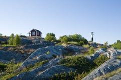 Hütte und Leuchtturm Lizenzfreie Stockfotos