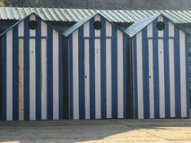 Hütten in einer Reihe Stockbild