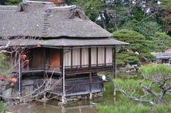 Hütten im Garten Lizenzfreie Stockfotos