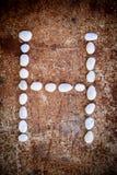 'H' alphabet made form white stone Royalty Free Stock Image