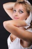 härlig kvinna för handskeståendewhite Royaltyfri Fotografi