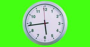 H24 hours timelapse seamless loop ready, clock hands movement, modern white metallic alarm wall clock on chroma key green screen. Background stock video