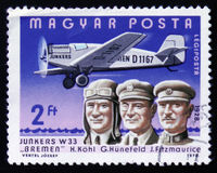 H. Kohl, G. Hunefeld, J. Fitzmaurice with Yunkers W33 `Bremen`. MOSCOW, RUSSIA - FEBRUARY 12, 2017: Stamp printed in Hungary shows H. Kohl, G. Hunefeld, J royalty free stock images