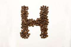 H the letter. alphabet of coffee. Coffee beans. concept of healthy eating. photo for your design. horizontal orientation of the sheet royalty free stock photography