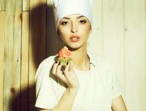 H?llande muffin f?r kvinna royaltyfri bild