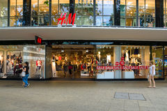 H&M store on the Kurfuerstendamm. BERLIN - JULY 24: H & M store on the Kurfuerstendamm. H & M Hennes & Mauritz AB (H & M) is a Swedish multinational retail Royalty Free Stock Image