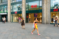 H&M store on the Kurfuerstendamm. BERLIN - JULY 24: H & M store on the Kurfuerstendamm. H & M Hennes & Mauritz AB (H & M) is a Swedish multinational retail Royalty Free Stock Images
