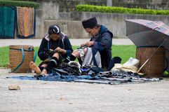 H'mong women at work. H'mong women sewing hand-made clothes, blankets, pillow cases, etc, which are very popular among tourists nowadays. H'mong is a north Stock Images