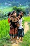 H'mongmeisjes die in Bac Ha glimlachen royalty-vrije stock fotografie