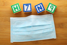 H7N9 alphabet block with face mask Stock Photo