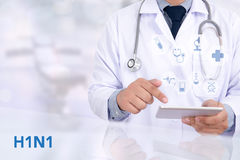 H1N1. Medicine doctor working with computer interface as medical Stock Image