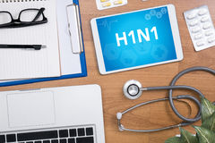 H1N1. Professional doctor use computer and medical equipment all around, desktop top view Stock Photo