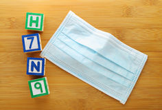 H7N9 toy block with protective face mask Royalty Free Stock Image