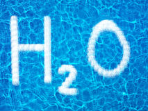 H2O on water Stock Photo