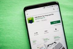 H&R Block税预习功课和文件应用程序 库存图片