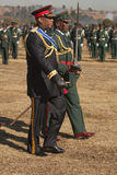 H.R.H King Letsie of Lesotho. Side view of H.R.H King Letsie walking in military uniform inspecting troops on parade for his birthday; Lesotho Stock Photography