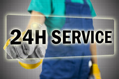 24h service. Closeup of contractor choosing 24h service button on virtual screen Royalty Free Stock Photo