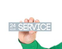24h service. Woman holding a label with 24h service Royalty Free Stock Photos