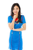 Hôtesse d'air asiatique se tenant avec la main sur le menton photo stock