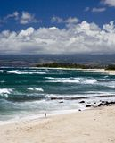 H17 North Shore Beach. Small swell on Oahu's North Shore.  No surfers today, leaving the beach open for beachcombers and fishermen on a brilliant Hawaii Royalty Free Stock Photo