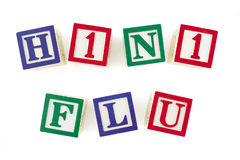 H1N1 FLU Alphabet Blocks Viewed From Above. Alphabet blocks arranged to form 'H1N1 FLU' in two rows.  Subject is viewed from above Stock Photo