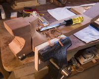 H24 Forming the Neck. Handmade guitar neck in the vise Royalty Free Stock Photos