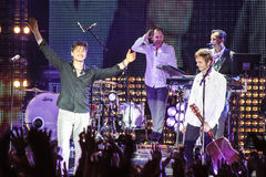 A-ha band (Morten Harket, Paul Waaktaar-Savoy, Magne Furuholmen) performs during the live concert in Minsk on November 6, 2010 Stock Image
