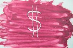 Ha dipinto il simbolo di dollaro sulla struttura del rossetto della sbavatura del campione Immagini Stock