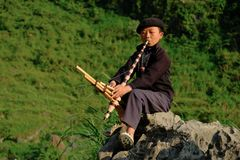 Ha Giang / Vietnam - 31/10/2017: Local Vietnamese boy playing a traditional instrument in the North Vietnamese region of Ha Giang royalty free stock photography