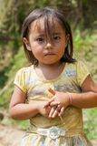 Ha Giang, Vietnam - Sep 22, 2013: Portrait of Hmong little girl child in front of her house.  Stock Photo
