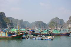 Ha Long Bay. Colourful and busy floating village in Halong Bay, Vietnam Royalty Free Stock Photo
