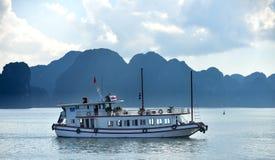 Ha Long Bay - cruise boat. Group of vietnamese boats anchored in lush bay. Ha Long Bay - Vietnam Stock Images
