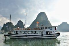 Ha Long Bay - cruise boat. Group of vietnamese boats anchored in lush bay. Ha Long Bay - Vietnam Stock Photo