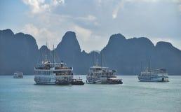 Ha Long Bay - cruise boats. Group of vietnamese boats anchored in lush bay. Ha Long Bay - Vietnam Royalty Free Stock Photo