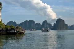 Ha Long Bay - cruise boats. Group of vietnamese boats anchored in lush bay. Ha Long Bay - Vietnam Royalty Free Stock Photography