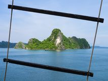 Ha Long Bay formations through a boat rope ladder, Vietnam. Ha Long Bay karst formations through a boat rope ladder, Vietnam Stock Photo