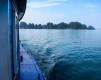 Ha Long Bay islands, seascape and tourist boat on water, Ha Long, Vietnam.  stock images