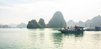 Ha Long Bay islands, tourist boats and seascape with light reflection on water, Ha Long, Vietnam.  stock photography