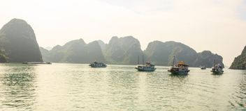 Ha Long Bay islands, tourist boats and seascape with light reflection on water, Ha Long, Vietnam.  royalty free stock photos