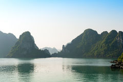 Ha Long bay and silhouettes mountains Royalty Free Stock Photos