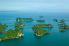 Ha Long Bay view from above, fisher farm in Halong bay. Ha Long Bay. UNESCO World Heritage site. Ha Long Bay, in the Gulf of Tonkin, includes some 1,600 islands stock photos
