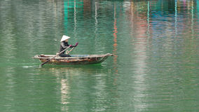 HA LONG BAY, VIETNAM AUG 10, 2012 - Food seller in boat. Many Vi Royalty Free Stock Image