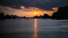 Ha Long Bay, Vietnam - December 02, 2015: Sunrise at Halong Bay, Vietnam. Unesco World Heritage Site. Most popular place in Vietna Royalty Free Stock Images