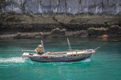 Famous UNESCO heritage site Ha Long Bay with fancy rocks, turquoise water and boats stock photo