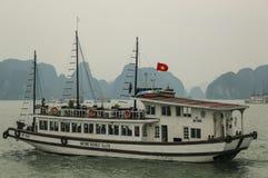 HA LONG BAY, VIETNAM - MARCH 28, 2016:Tourist cruise ship in Ha Long Bay, Vietnam stock photography