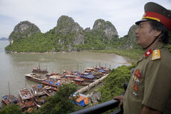 Ha Long Bay with Vietnamese officer Royalty Free Stock Images