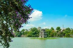 Hoan Kiem lake in Hanoi. HA NOI- VIETNAM: The Hoan Kiem lake in center of Hanoi capital, Vietnam. The temple floating on the lake is symbol of Hanoi city royalty free stock photo