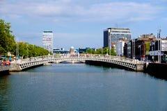 Ha'penny bridge. Dublin, Ireland. August 18, 2015. Ha'penny Bridge over the River Liffey. Liberty Hall in the background Stock Photography