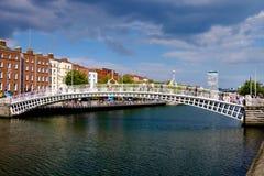 Ha'penny bridge. Dublin, Ireland. August 18, 2015. Ha'penny Bridge over the River Liffey. Liberty Hall in the background Royalty Free Stock Image